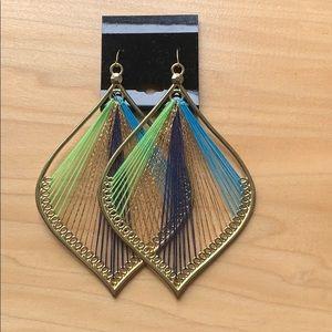 Big threaded golden earrings